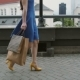 Legs Slender Young Woman, Walking in the City Down the Street with Shopping Bags