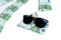 Banknotes of 100 euro and sunglasses