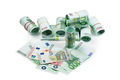 Euro banknotes in stacks and rolls