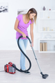 woman vacuuming the house