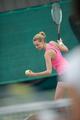 young beautiful woman playing tennis