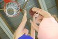 Woman aiming for basketball net