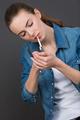 woman lighting a cigarrette