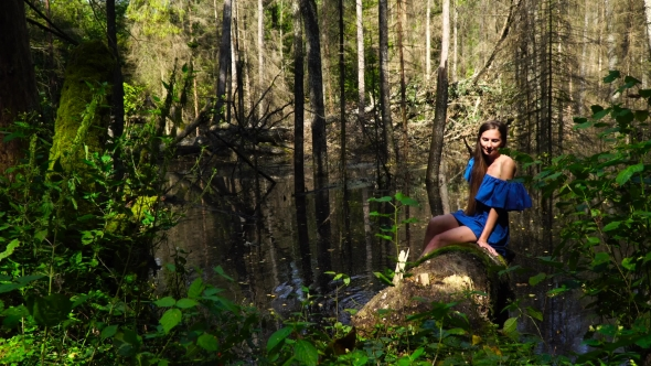VideoHive A Woman in a Blue Dress on the Background of Wild Nature 19127322