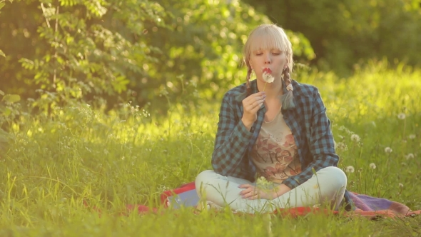 VideoHive Young Fashion Woman Blowing Dandelion 19128494