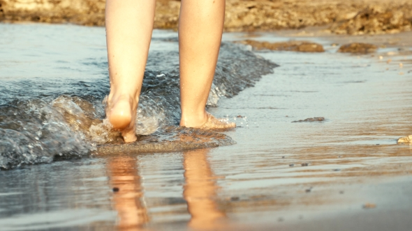 VideoHive Woman Legs Walking on Golden Sand Beach 19129682