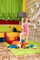 Little girl has won a game against the clown.