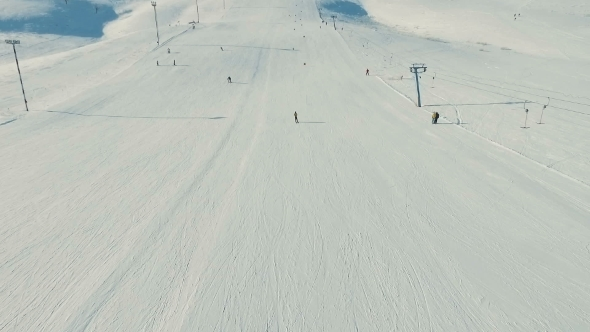 VideoHive Several People Ride Ski By Snow Slope View From Ropeway in Motion 19135750