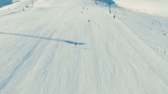 VideoHive Several People Ride Ski By Snow Slope View From Ropeway in Motion 19135859
