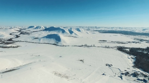 VideoHive Aerial Shot of Mountains and Fields By Ski Resort 19136332