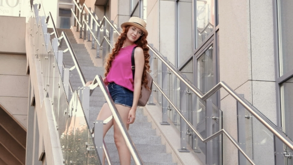 VideoHive Beautiful Young Girl Posing on Steps in a City Background 19138778