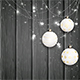 White Christmas Balls on Black Wooden Background