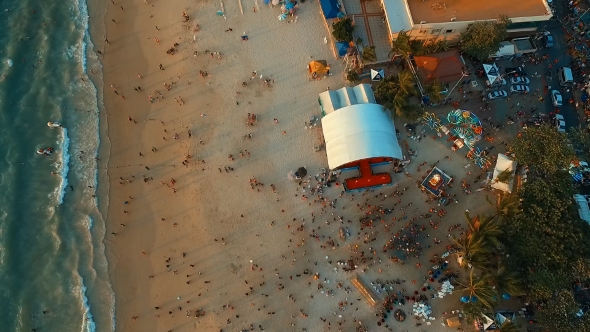 VideoHive Aerial Big Stage and Many People Celebrating Songkran on the Beach 19149902