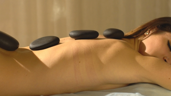 VideoHive Young Woman Getting Hot Stone Massage in Spa Salon 19153525