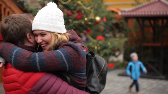 VideoHive Romantic Dating Couple on the Christmas Fair Man Is Rotating His Hugged Girlfriend Around Xmas 19155245