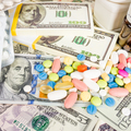 Money and pills. Pills of different colors on money. medicine co