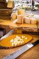 piece of cheese. cheese on a wooden table with knife