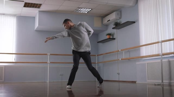 VideoHive Young Guy Makes Beautiful Dance Moves in a Dance Studio 19158465