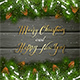 Christmas Lettering on Black Wooden Background with Fir Tree Branches