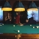 Man Plays Billiards and Two Young Beautiful Women Watching the Game