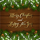 Christmas Lettering on Wooden Background with Fir Tree Branches