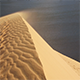 Sand Blowing Over The Dunes