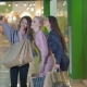 Three Beautifull Young Girls Holding Shopping Bags, Taking Picture, Making Selfie. Girls Laughing