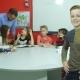 Redhead Schoolboy Stands Near a School Board Smiling