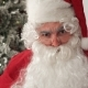 Santa Claus in Eyeglasses Pulling Funny Faces and Laughing