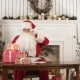 Santa Claus Arranging Presents on His Table