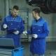 Two Auto Mechanic in Blue Uniform Preparing the Car for Full Diagnostics