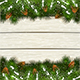 White Wooden Background with Christmas Fir Tree Branches and Snow