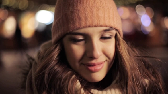Happy Young Woman in Winter Hat on Christmas