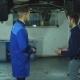 Auto Mechanic and Car Owner. Confident Auto Mechanic Explaining Something To