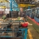 Conveyor Assembly Stage the Body of Tractor at Factory