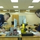 Two Young Engineers Working on a Project Together in Science Lab
