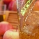 Apple Juice Apple Juice Is Poured Into a Glass and Basket Apples
