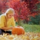 Woman Causes Pattern on the Pumpkin. Preparing for Halloween