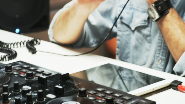 VideoHive Disc Jockey's Face and Hands While He Changes Settings of the Sound Control System 19231594
