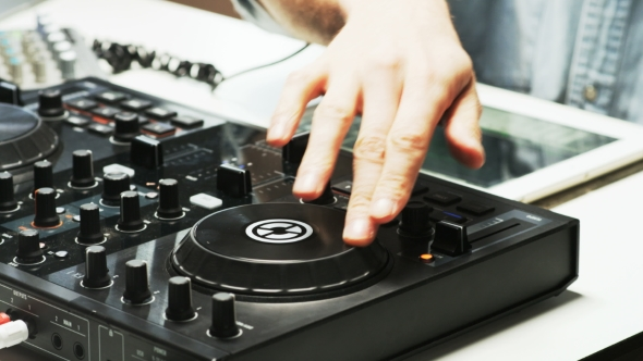 VideoHive Disc Jockey's Hands and Face While He Changes Settings of the Sound Control System 19231688