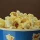 Salty Popcorn Slowly Rotates on Brown Background