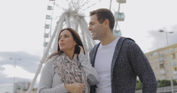 VideoHive Young Couple Standing in Front of a Ferris Wheel 19238683