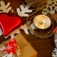 Christmas and New Year Background with Presents, Lights, Candles and Different Decorations. Gift in