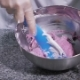 The Process of Mixing Raw Almond Dough for Proper State in a Metal Bowl, with the Help of Blue