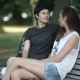 Two Girls Lesbians Relaxing in the Park on a Bench