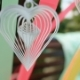 White Paper Heart Whirls Among Ribbons