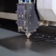 Industrial Laser Cutter with Sparks. The Programmed Robot Head Cuts with the Aid of a Huge Sheet of