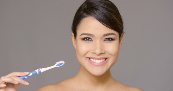 VideoHive Smiling Friendly Young Woman Brushing Her Teeth 19263058