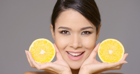 VideoHive Pretty Smiling Woman Holding Lemon Halves 19263076