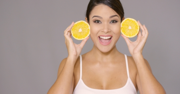 VideoHive Happy Healthy Woman Holding Up Sliced Oranges 19263113